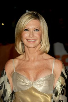 """Breast cancer survivor Olivia Newton John is no longer concerned with aging. In 2004, the Australian sweetheart told Andrew Denton that her experience with cancer had helped to change her perspective.""""I shed an innate fear of dying. When I read some of my old interviews, I would talk about that or I would talk about getting old and dying. Now I'm grateful to get old. I"""
