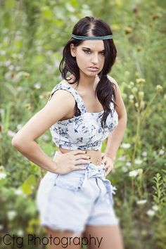 love everything about this! the top the shorts hippie band dark hair makeup the flowers...