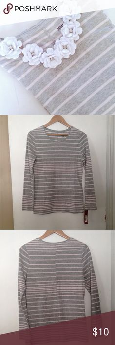 striped long sleeved tee Adorable grey and baby pink striped long sleeved tee by Merona. Soft and cozy! I love the look of a simple tee like this paired with a big statement necklace. Stretchy cotton fabric. Brand new with tags. Size medium.🎉Host Pick 4/28🎉 / tee, tshirt, t-shirt, top, striped, stripped, stripes, cotton, soft, long sleeved, merona, target / Merona Tops Tees - Long Sleeve