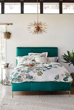 Tropical-inspired blooms lend a vibrant accent to the boudoir.