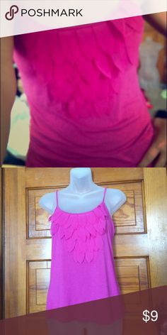 Frilly Pink Tank Ultra feminine pink tank adorned with soft petals for an adorable look!  98% Rayon 4% Spandex.  Want this cheaper?? ⭐️Bundle any two or more items and save 30% off your total!!⭐️ Candie's Tops Camisoles