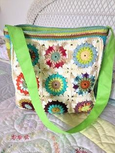 Sunburst Granny Square Market Bag. Free pattern for crochet squares, plus notes on this particular project using an upcycled bag. by jane.burns.3194