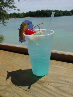 Adios MF - 1/2 oz vodka  1/2 oz rum  1/2 oz tequila  1/2 oz gin  1/2 oz blue curacao liquer  2 oz sweet and sour mix  2 oz 7-Up soda