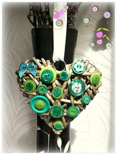 Green buttoned wicker hanging heart