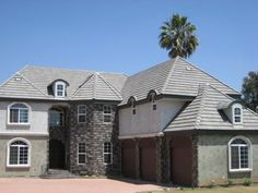 Tile Roof installed by IMMACULATE ROOFING CO.