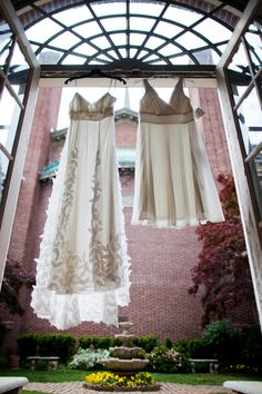 Beautiful casual & short wedding dresses from Anne + Jess' DIY garden themed wedding in blue & green in Washington, DC. Images by Photo Lady Love.