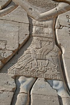 detail of relief carving of the figure of Trajan as Pharaoh with a girffin trampling the emperor's enemies - on Dendera Temple *see pin above on this board for full figure relief