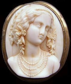 Goddess Flora     Materials: ivory, brass  Date and origin: Germany, ca 1830  Size: 2 3/4 x 2 5/16 inches  Condition: excellent. Hairlines due to the age