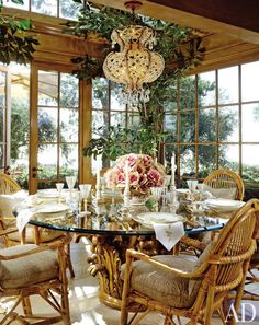 Unlike the terraces, where the outside is made to feel like an interior, this is an interior space but feels like an exterior, architect Richard Landry says of the breakfast room of an Italian-village-inspired California home. Its ceiling and outer walls are glass. A French beaded-crystal chandelier is over a table whose base was made from a Portuguese gilt-wood Corinthian capital.