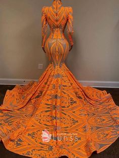 This brilliant orange prom dress features halter plunging V neckline sheer bodice with long sleeves. The figure-flatting mermaid skirt with cathedral train hugs the body to showcase curve. Black Girl Prom Dresses, African Prom Dresses, Cute Prom Dresses, Prom Dresses Long With Sleeves, Prom Outfits, Glam Dresses, African Dresses For Women, Mermaid Prom Dresses, African Fashion Dresses