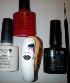 Paint the face with CND Shellac and a nr1 paintbrush. Put the nail in the CND UV-lamp for 2 minutes.