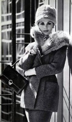 Paris 1959 - In Paris the world of fashion continues to be inspiring and elegant.  What can be more perfect then this coat and touch of fur?