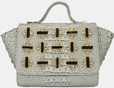 Patent leather with jewel decorated flap, crocodile finish.