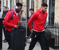 Liverpool striker Daniel Sturridge and midfielder Emre Can make their way towards hotel's entrance