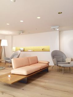 The Oculus CH468 and ottoman CH446 by Hans Wegner - Carl Hansen & Son, available at the best pricing through MorlenSinoway.com