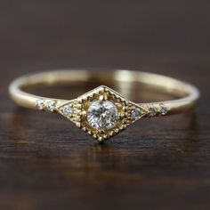 Unique art deco inspired hexagon engagement ring featuring ethically sourced G SI white diamond. Offered in recycled yellow, rose, white gold or platinum :: Main diamond: / / G color :: Side stone: 6 melee diamonds / :: Band width: half round Hexagon Engagement Ring, Deco Engagement Ring, Rose Gold Engagement Ring, Ring Set, Ring Verlobung, Gold Diamond Wedding Band, Diamond Rings, Diamond Art, Halo Diamond