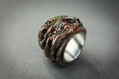 This ring was inspired by deep and old textures of tree bark where you can find moss, mould and mushrooms of all sorts of natural wonderful