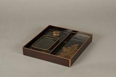 江戸時代 月梅枝蒔絵螺鈿硯箱  <br/>Writing Box with Design of Plum Blossoms and Moon Period: Edo period (1615–1868) Date: 18th century Culture: Japan Medium: Reddish-brown lacquer with gold hiramaki-e, lead, and mother-of-pearl inlay Dimensions: H. 1 1/2 in. (3.8 cm); W. 8 1/4 in. (21 cm); L. 8 3/4 in. (22.2 cm) Classification: Lacquer