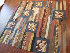 Odd Block Strip Quilt - Would be a great way to showcase feature fabrics in a modern look