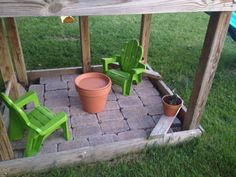 Pavers under the swingset! Made a little tea party area for the girls! Their tea set is inside their terra-cotta pot table! Thinking of adding 2 more chairs for when their friends are over Swing set project! Playset Diy, Backyard Playset, Outdoor Playset, Backyard Playground, Kids Swing Sets, Toddler Swing Set, Backyard Makeover, Sanding A Deck, Inside Playhouse