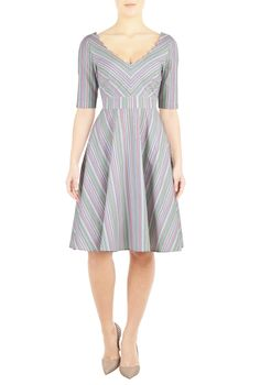 Woven cotton pinstripe is shaped into our scallop trimmed dress styled with a wide V-neckline, princess seamed bodice, banded waist and full skirt for a flattering silhouette.