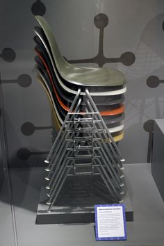 In 1954, a new utilitarian base was added to the molded plastic chair shell that allowed chairs to easily stacked for storage. One of Eames Office's most recognizable designs, the stacking chairs are have been in continuous production since 1954 and have seated countless students around the world for over 50 years.