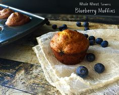Whole wheat muffins that are fluffy, moist, bursting with blueberries, and a kick of turmeric is a great and healthy option for your morning! |  @TheKitcheneer