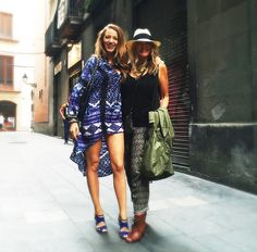 Blake Lively wears a printed blue dress paired with matching blue sandals and a black bag