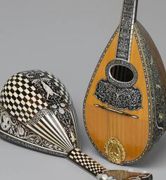 Mandolins crafted by Angelo Mannello (1858-1922) known for his ornately inlayed mandolins, New York City circa 1900.