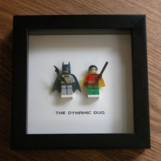 Art frame feature two LEGO®️️ Superhero minifigures, Batman and Robin with the famous quote: 'The Dynamic Duo' beneath. Its the perfect gift for any occasion—birthday gift, wedding gift, anniversary gift, valentines day gift, graduation gift, just because gift. Popular with fans of the Superman®️️ films and LEGO®️️ lovers. An awesome gift for that special nerdy someone, kids, or as a little treat for yourself, or for a wedding party.  Frame size: 6 inch x 6 inch (15