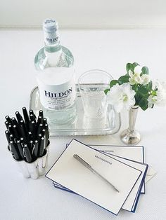 Keep It Practical and Stylish - English bottled water by Hildon on silverplate tray. Sterling silver Victorian bud vase and personalized stationery. Guest Bedrooms, Hotel Bedrooms, Room Essentials, Guest Suite, Pen And Paper, Bud Vases, B & B, Bed And Breakfast, Vignettes