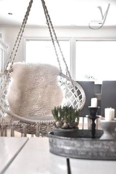 I love so much those hanging chairs...