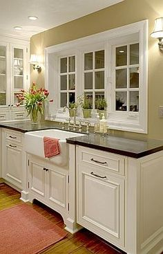i like that theres no cabinets by the windows, just the lights...pretty. great way to open a seperated dinning room