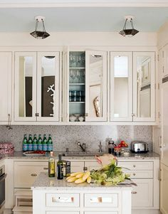 love these mirrored uppers.  adds a lot of glamor to a simple kitchen.