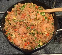 Better-than-take-out-fried-rice, 5 Smart Points @weightwatchers Fried Rice Serves: 6 Ingredients : 4cup(s)cooked brown rice 1pound(s)cooked shrimp 1⁄2largeuncooked onion(s), Diced 1cup(s)cooked frozen peas and carrots, Frozen 1Tbsp sesame oil 1Tbsp olive oil 4clove(s)garlic clove(s), Minced 1⁄4cup(s)low sodium soy sauce 2item(s)egg(s) Instructions 1 .Prepare rice according to package instructions to yield 4 cups cooked rice. 2.Heat sesame oil in a large skillet on medium heat. 3.Add onion,