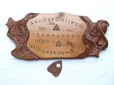 Etsy listing at https://www.etsy.com/listing/156520445/ouija-board-handcarved