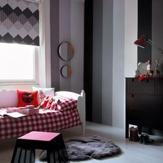 I am loving the look of black and white kid's rooms....with that jolt of color :)