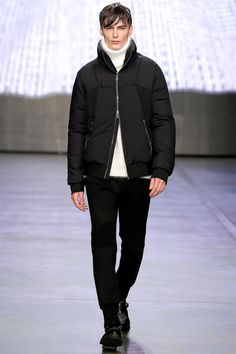 Federico Curradi presented his Fall/Winter 2014 collection for Iceberg during Milan Fashion Week. The classic traditional inspiration evolves into a high tech dimension through an inventive use of textures and prints.