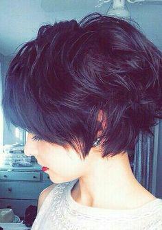 Short dark growth pixie hair