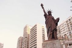 An iron replica of the Statue of Liberty in Barrancas De Belgrano Square, Buenos Aires, Argentina - Bizarre Replicas of the Statue of Liberty and the Eiffel Tower