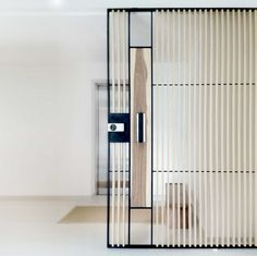 Sliding door in steel-glass-wood by 0932 Design consultants, Singapore.