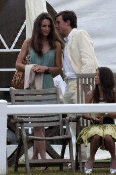 Kate Middleton watches Prince William and Prince Harry play polo at the Beaufort Polo Club.