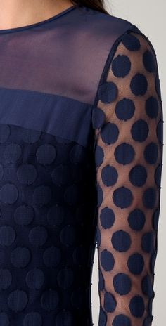 chiffon cool for the summer... navy blue polka dot mesh dress features a scoop neck.