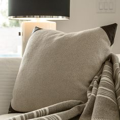 PURLEAR- a sumptuous bolster of cotton, wool, and leather made in USA. Timeless sophistication.