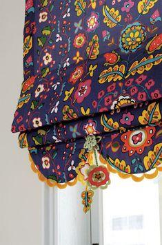 scallop trim on scalloped skirt on roman shade