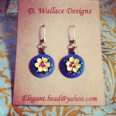 Flowers in a tire earrings. Antique buttons, crystals and flower shaped findings.
