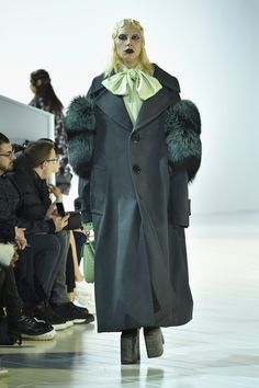 Lady Gaga Wool Coat - Lady Gaga walked the Marc Jacobs runway wearing an oversized gray wool coat with teal fur sleeves.