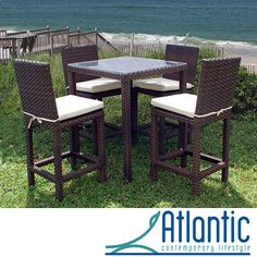 Entertain in style on your patio with this elegant outdoor bar set. The glass-topped table and four chairs are made of rust-resistant cast aluminum, so you can enjoy the set for years to come, while the ivory chair cushions make the seating comfortable.