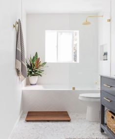 Vanity: Home Depot Mirror: Faucet: Restoration Hardware Vanity Light: Etsy Showerhead: Restorati Bad Inspiration, Bathroom Inspiration, Beautiful Bathrooms, Modern Bathroom, White Bathroom, Bathroom Beach, Master Bathroom, Small Bathroom With Tub, 1920s Bathroom