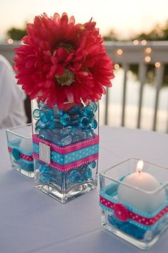 DIY Centerpiece :  wedding Centerpiece    except with orange marbles and navy blue flowers and a grey ribbon?